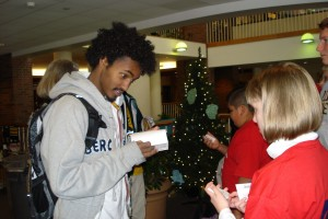 Henock Yeman, a sophomore from Ethiopia, ponders a question from a visiting fifth-grader.