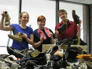Lauren Paley, Kasi Carter, and Andrew Baird spent two days boxing donated shoes.