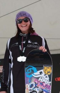 Chloe Banning '14 on the podium at the USASA Nationals. Note the CC Tiger sticker on her snowboard.