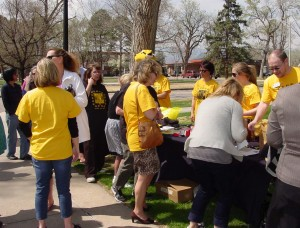 The Wellness Team set up a table with food, water, and giveaways