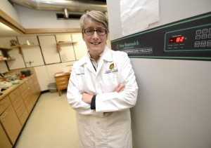 Peggy Daugherty, associate professor of chemistry, with a new high-efficiency freezer.