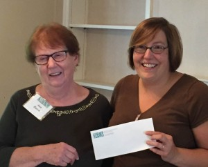 CC's Special Collections curator and archivist Jessy Randall accepts a $10,000 gift from the Woman's Educational Society.