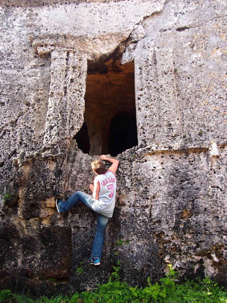 In true CC style, a student scales the ancient caves which were hand-carved to add ornamentation to burial chambers at the necropolis of Cala Morell