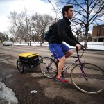 """Patrick Jurney '17 delivers food as part of Colorado Springs Food Rescue's effort to help meet hunger needs in the community while reducing the amount of food wasted on campus. One of the group's goals is to get food delivered within 30 to 45 minutes of pickup, allowing them to achieve what many say is impossible: """"nutritious fast food."""""""