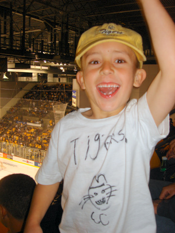 """Nathan Calhoon is already a dedicated CC hockey fan. The 7-year-old son of John Calhoon '93 made his own CC Tigers hockey shirt. John lives in Castle Rock, Colo., with his wife, Kate, and his two sons. He coaches soccer, works as a partner in a business-consulting firm, and says he """"misses CC intramural hockey games.""""  He says he would love to hear from other Tigers. (jcalhoon@sandcherryassociates.com)"""