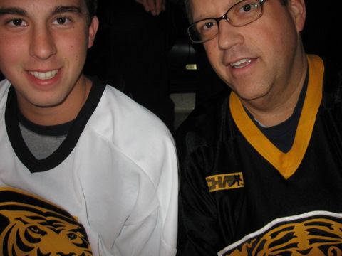 """Brad Friedman '82 and his son Brandon cheered on the Colorado College hockey team at the CC vs. North Dakota series in North Dakota. """"The temperature of -17 degrees felt even colder inside … when CC lost in overtime,"""" Brad says. """"The Saturday game ended in a tie, with the Friedmans spending their time combing popcorn out of their hair and wringing out beer that was 'accidently' spilled on their jackets. Even so, the trip was a blast, and Brandon got to miss two days of school!"""""""