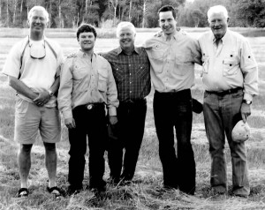 """Colorado College alumni attended a """"Fish and Chip"""" event at the Hole in the Wall Ranch in Johnson County, Wyo, in June. Enjoying a weekend of fishing, cowboy golf, and presentations and discussions about alternative energy are, from left, Ted Morton '71, Court Wold '06, Jack Wold '75, P'06, Jonathon Alegranti, and Van Skilling '55."""