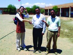 Pictured here, Lacey Ramirez '05 in her Peace Corps village in the province of Ouarzazate, Morocco. The two men are teachers from the local elementary school and members of the town NGO. They developed a project to construct a water cistern at the elementary school so that the children would have access to potable water. The men managed the project, while Lacey helped them raise 75 percent of the funds.