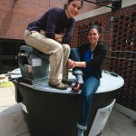 Students with the EarthTub food waste composter. Photo by Brad Armstrong.