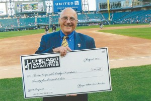 """Benjamin """"Bud"""" Greene '54 received a check for $25,000 at White Sox Park from White Sox Charities. The money was awarded for the U.S. Marine Corps Scholarship Foundation."""
