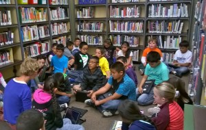 Lykkefry Bonde works with students in the library