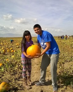 Andy Orozco Rivas and Center student with a prize pumpkin