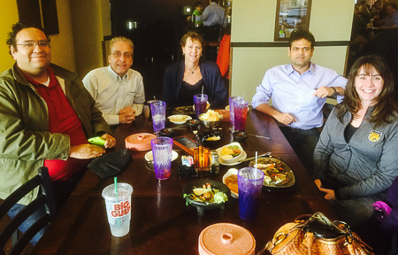 Manuel, Jim, Liz, Vish, and Tracey share a meal before Tracey's departure from the college.