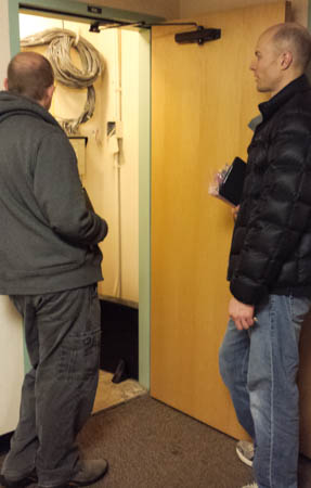 David Z. explaining what Chad and I are looking at in the closet (an edge switch).
