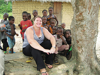 Beth Gaddis '99 enjoys working with children in Liberia. Her assignment there ends in May, and after a break, most likely spent visiting her U.S. home base of Denver, she heads to Pakistan for her next tour with the U.S. Agency for International Development.