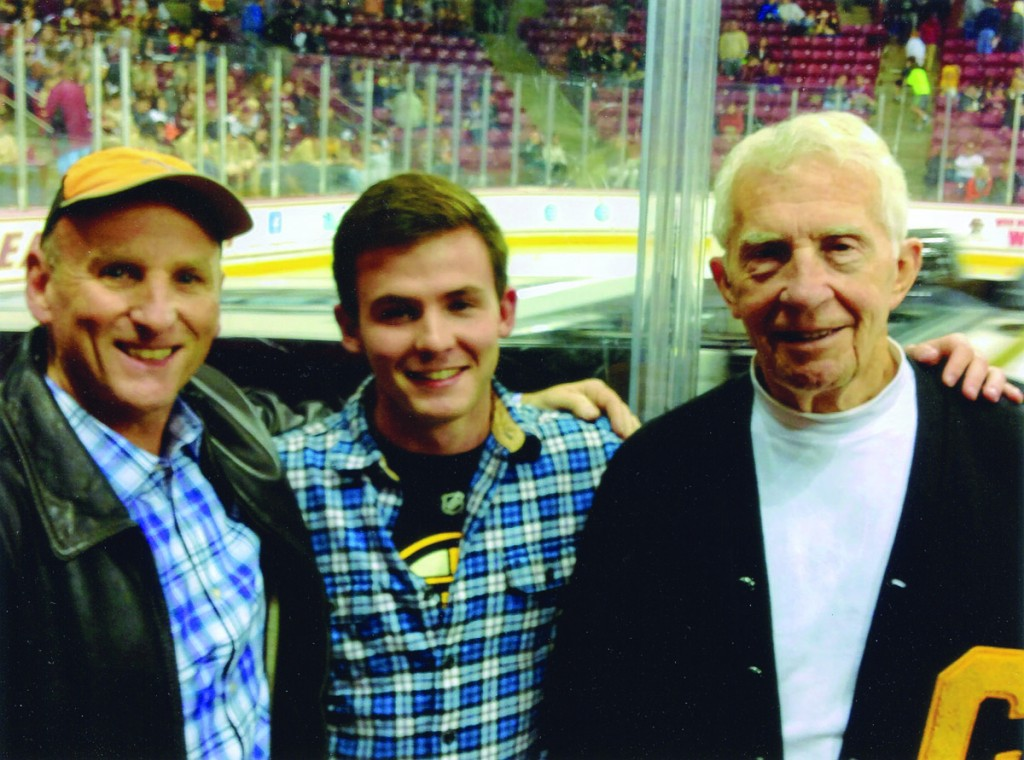 From left, three alumni from different eras met up at a hockey game in October in Boston. Patrick Barr, his son Sean '16, and Charles Crevo '59 watched Colorado College play Boston College. Charles, who is 82 years old, played football at CC. Sean's best friend is Charlie's grandson.