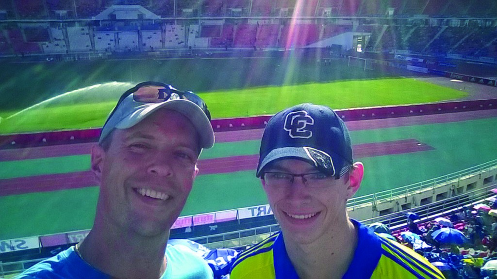 Jesse Worley MAT '96 reported taking his son (and a CC ballcap) to a recent soccer match between Chelsea Football Club and the Thai All-Stars in his current home city of Bangkok.