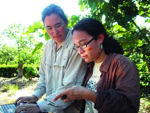 KERRI VIERLING '90 works with her student Alejandra Martinez in examining how different land uses (coffee field, sugar cane, pasture, and forest) in Costa Rica are affecting bird communities and the ecosystem services that they provide, like insect pest removal.