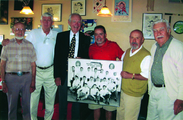 Friends of Roy Ikola '50 met for lunch and shared memories of the 1950 NCAA Championship hockey team. Roy, who died in 2007, was the goalie for that team and also played on an Olympic hockey team.  From left, players Clark Wilder '51, Bill McDonald '52, Don Bates '51, Trip Frasca '76, (son of Tony Frasca '52) Andre Gambucci '53, and Mike Yalich '50.  They are holding the 1950 team photo.