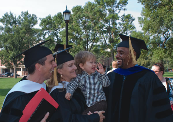Marc Acito '90, Krista Smith '86, Smith's son, 22-month-old Ford, and T.J. Cole '87 at Opening Convocation outside Shove Memorial Chapel. Photo by Leslie Weddell.