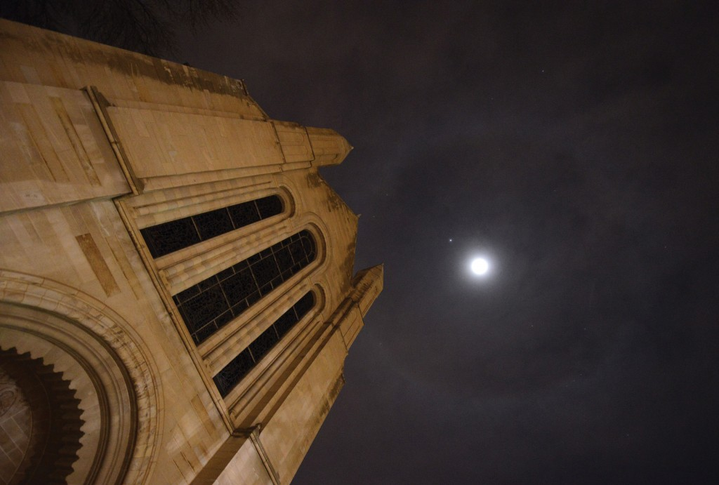 A rare lunar halo appears to float above Shove Chapel on a Sunday evening in March. The ring is light from the moon that is refracted and reflected through ice crystals floating in cirrus clouds 20,000 feet or more in the sky.
