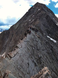 "Three CC  alumni and a friend summited Capitol Peak near Aspen in June. The group  included Stephen Limburg '04, Jonathan Mattes-Ritz '04, MAT '07,  Paquito Lopez '04, and friend Yevgeny Babinsky. The route took them along  the famous ""knife edge"" that drops 1,000 feet on either side. Stephen recently  completed his Ph.D. in mathematics at the University of Colorado-Boulder and is  working for a commodities hedge fund in Boulder. Jonathan teaches pre-algebra  and coaches lacrosse at an all-boys school in Washington, D.C., and Paquito has  finished his first year as a full-time science teacher at a public charter  school in Denver."