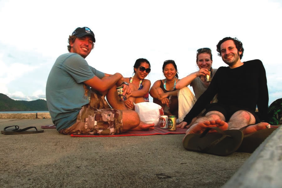 Ten years  after studying together at CC, three friends ran into each other on a remote  Thai island in April. From left: Chris Hennessey '04, Dalina  Prasertsri '03, friends Sarah and Kathrin, and Christian  Bierwirth '03.