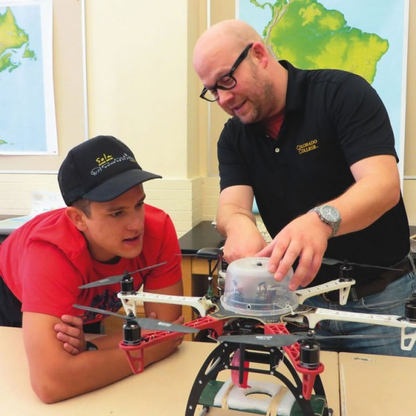 Noah Cutter '16, left, and CC Director of Innovative Technology Matt Gottfried discuss plans for modifying one of the unmanned aerial vehicles they built as part of the new drone program that's just taken flight. Photo by Pattye Volz