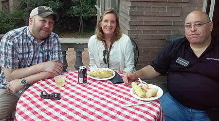 Matt, Danna, and Gerald enjoy some good food and good company.
