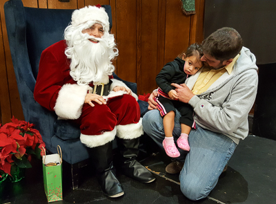 A little moral support from dad helps her kindle a new friendship with Santa.