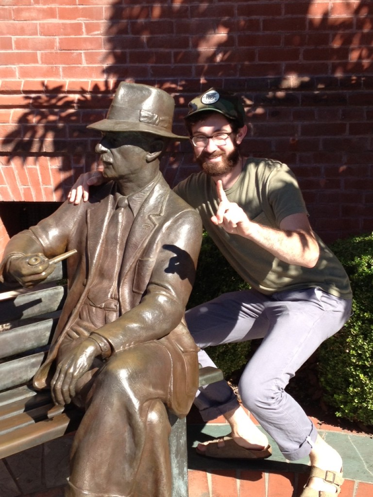 Student Will Schube with the Faulkner statue on the square in Oxford.